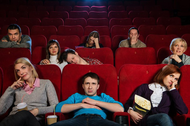 Group of bored people at movie theater